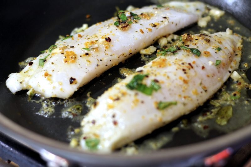 Two tilapia filets in a pan