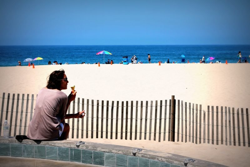 Man eating ice cream on the beach