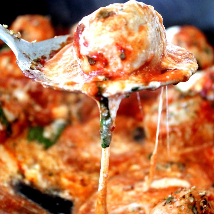 healthy turkey meatball in tomato basil sauce on a spoon