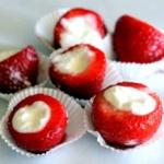 Five cheesecake stuffed strawberries