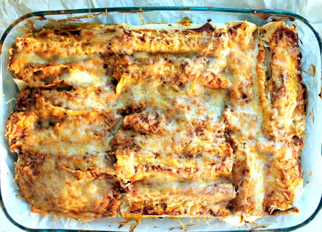 Spicy Black Bean Chicken Enchiladas With Pumpkin Sour Cream Sauce