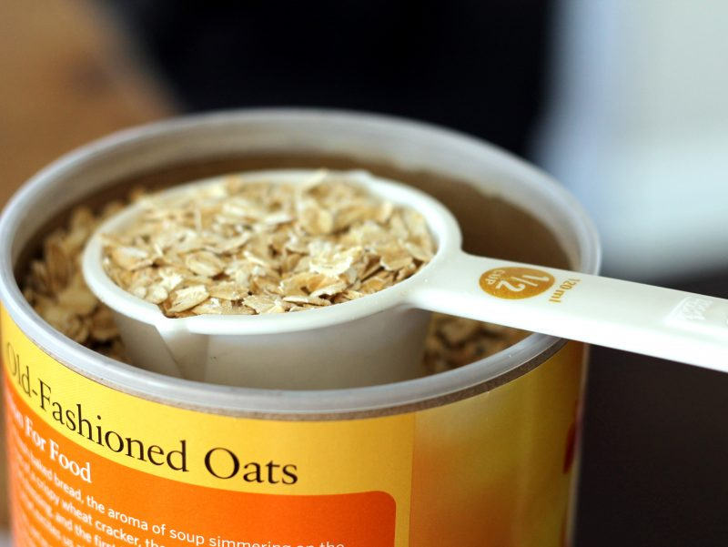 Scooping oats out of a canister