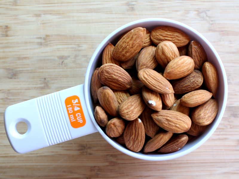 Almonds in a measuring cup