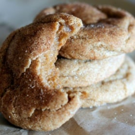 Brown butter snickerdoodle cookies with a bite taken out