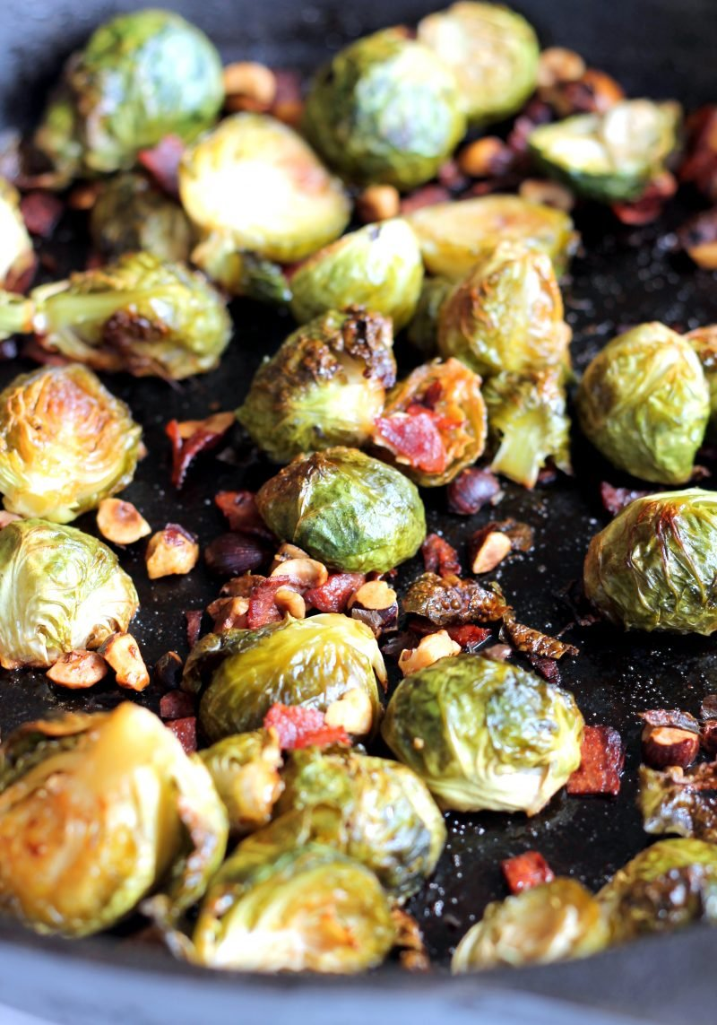 Maple roasted brussels sprouts with bacon in a skillet