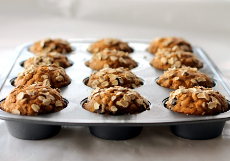 Pumpkin oatmeal chocolate chip muffins in a muffin tin