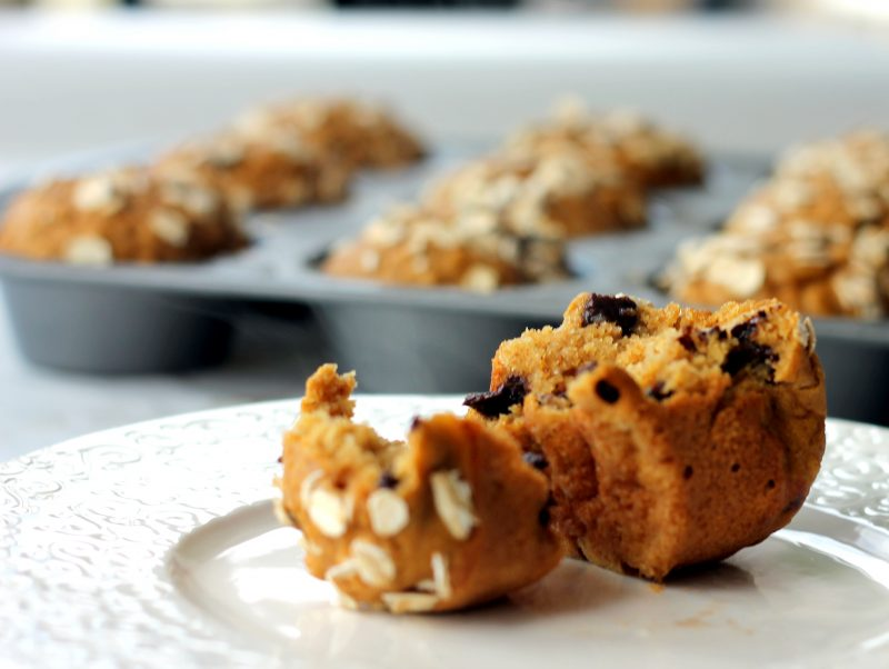 Pumpkin oatmeal chocolate chip muffins on a plate
