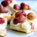 brie crostini topped with grapes
