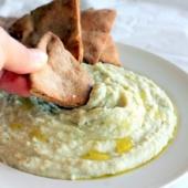 Bowl of white bean basil hummus with pita chips