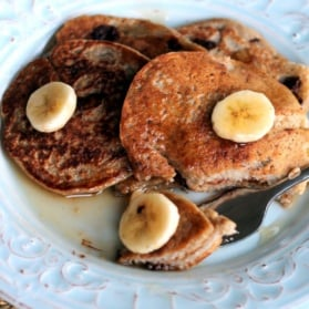 Oatmeal chocolate chip banana pancakes on a plate