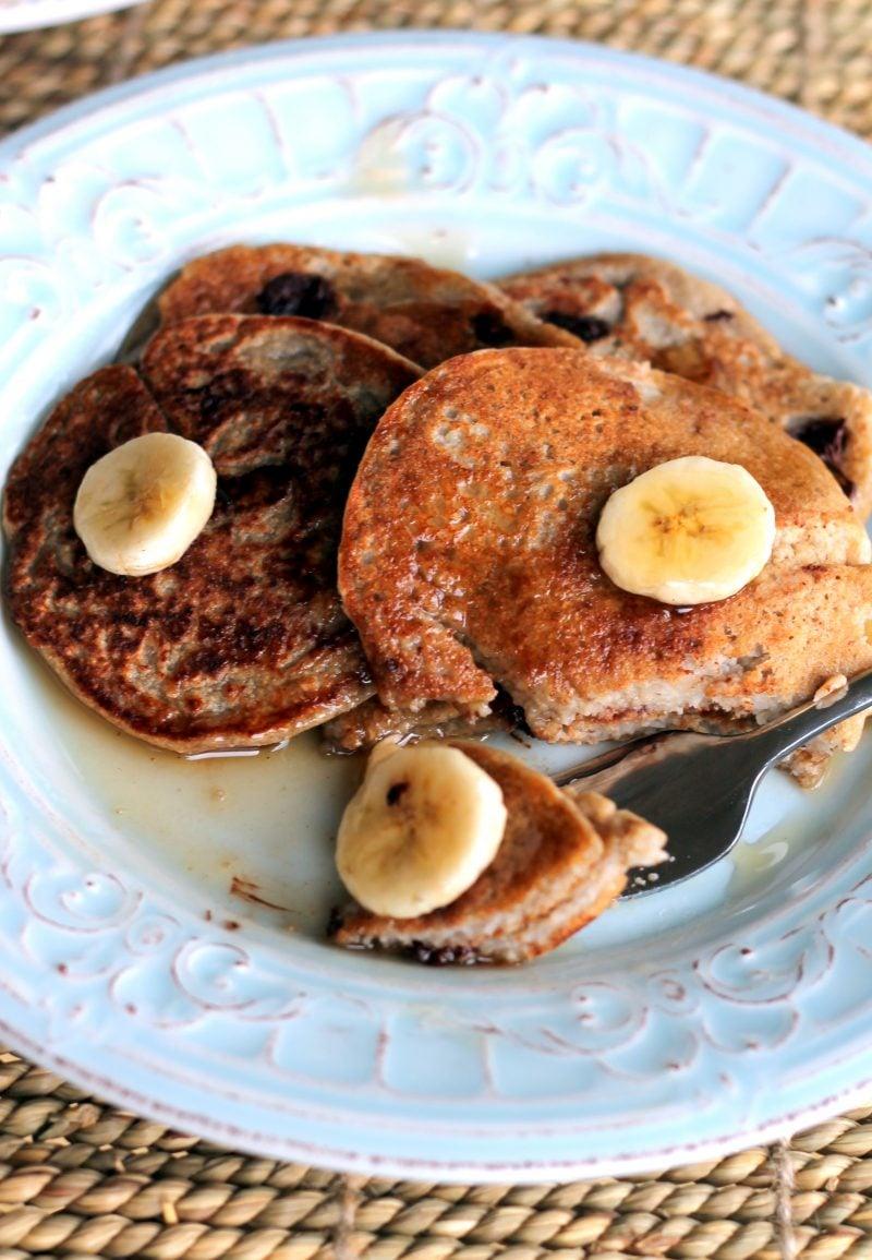Oatmeal chocolate chip banana pancakes on a plate