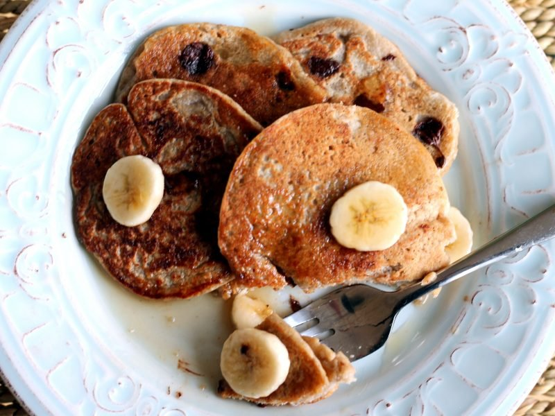 Oatmeal chocolate chip banana pancakes on a plate with a fork