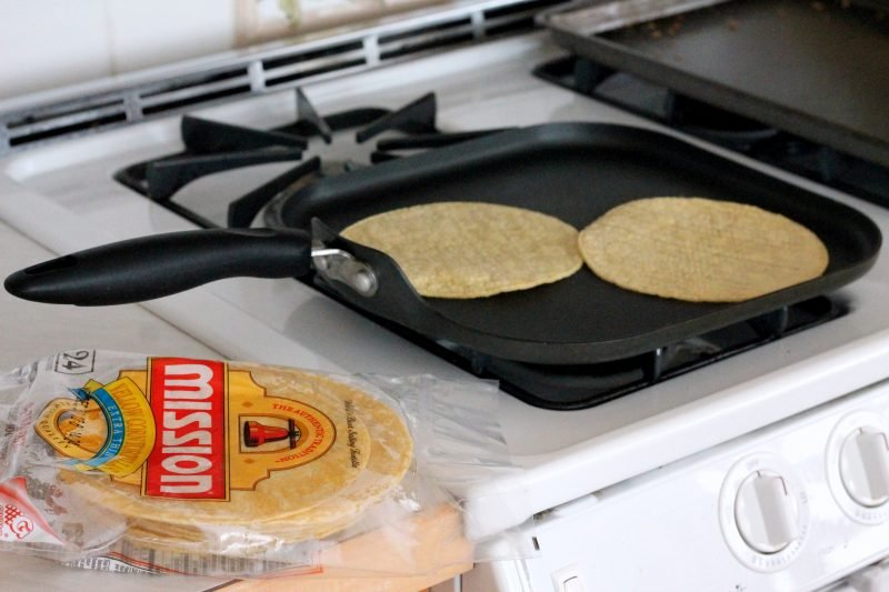 corn tortillas on a skillet