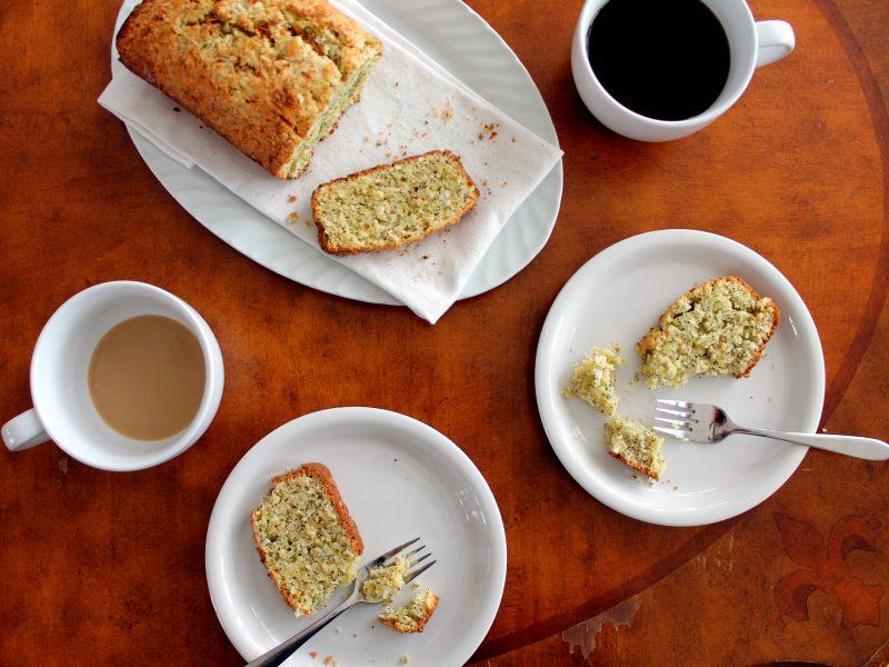 coconut lemon poppyseed bread on plate on a table