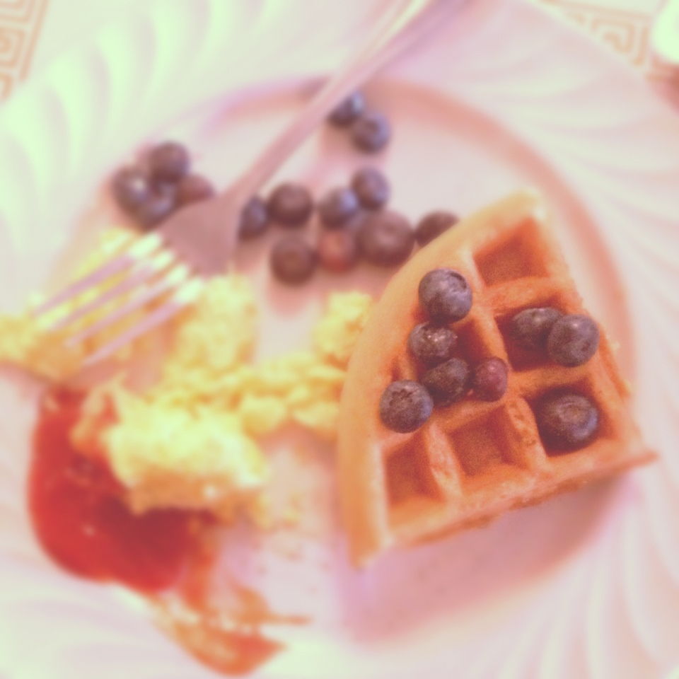 waffles, blueberries, and scrambled eggs on a plate