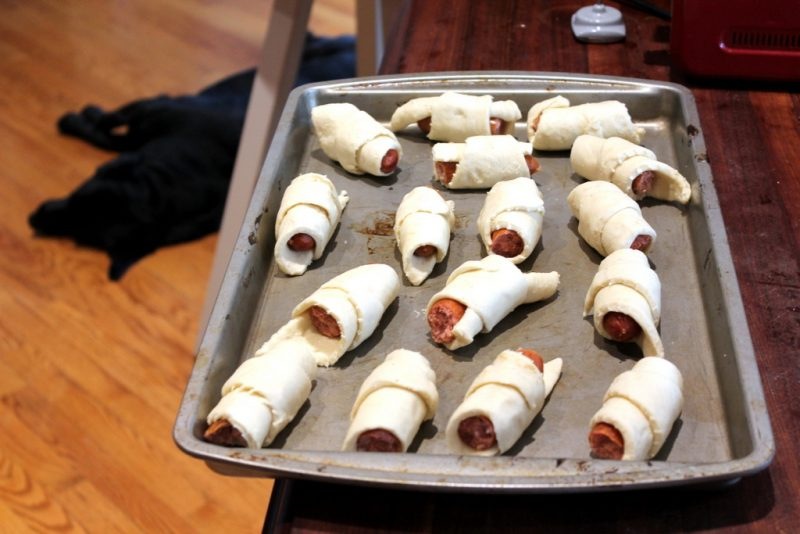 tray of hot dogs wrapped in dough