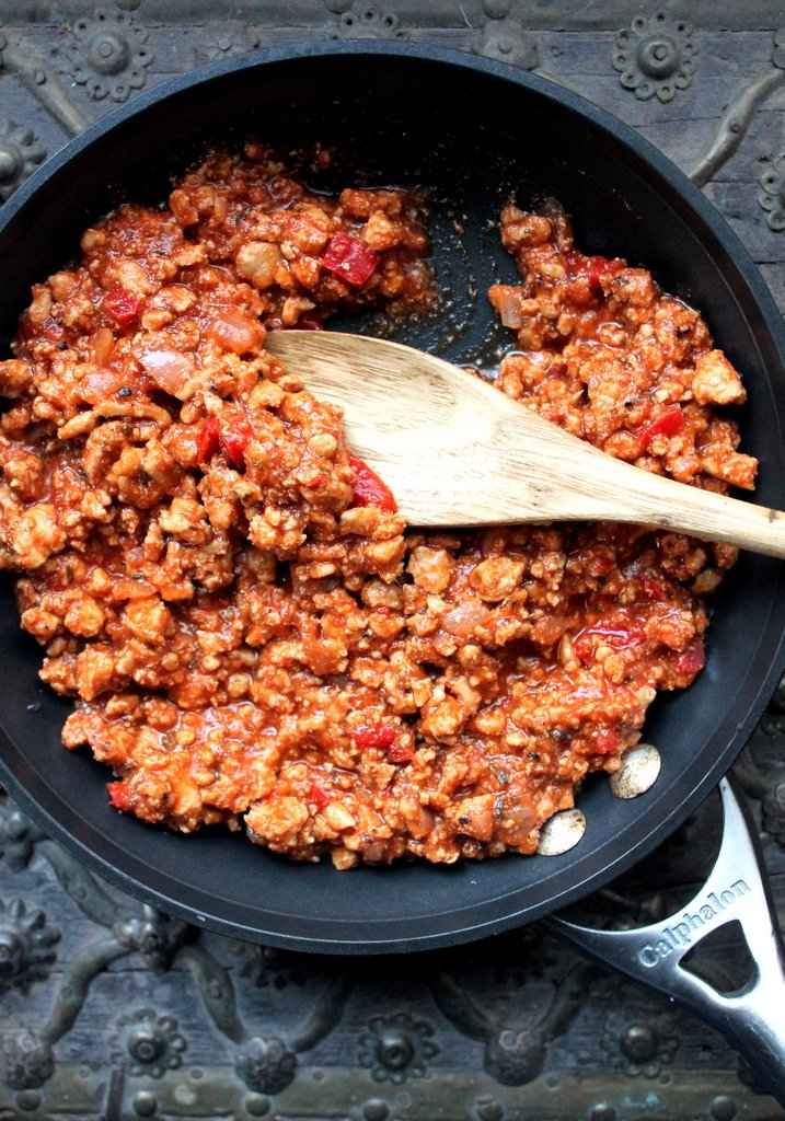 ground turkey and tomato sauce in pan