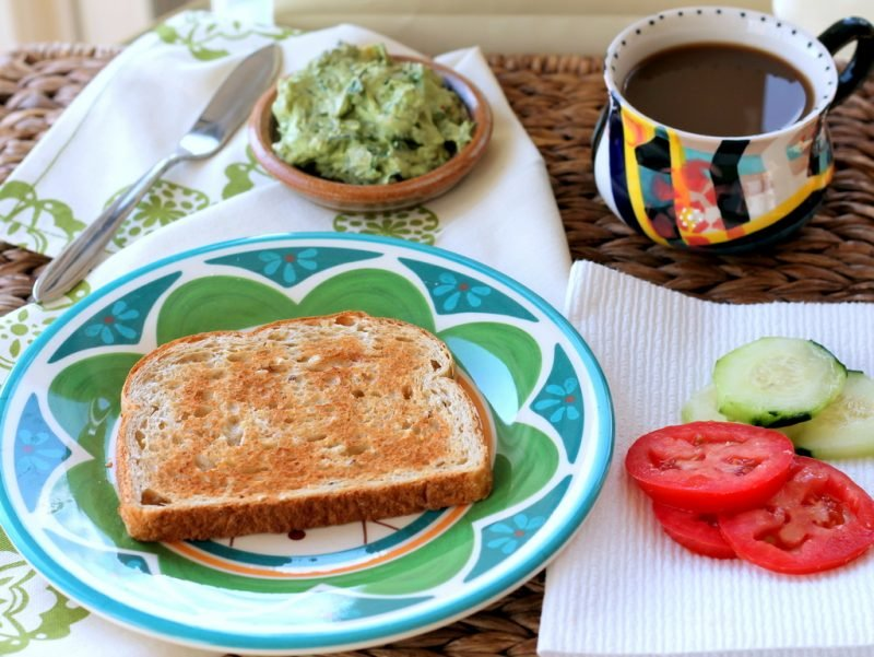 toast, avocado, vegetables, and cup of coffee on table