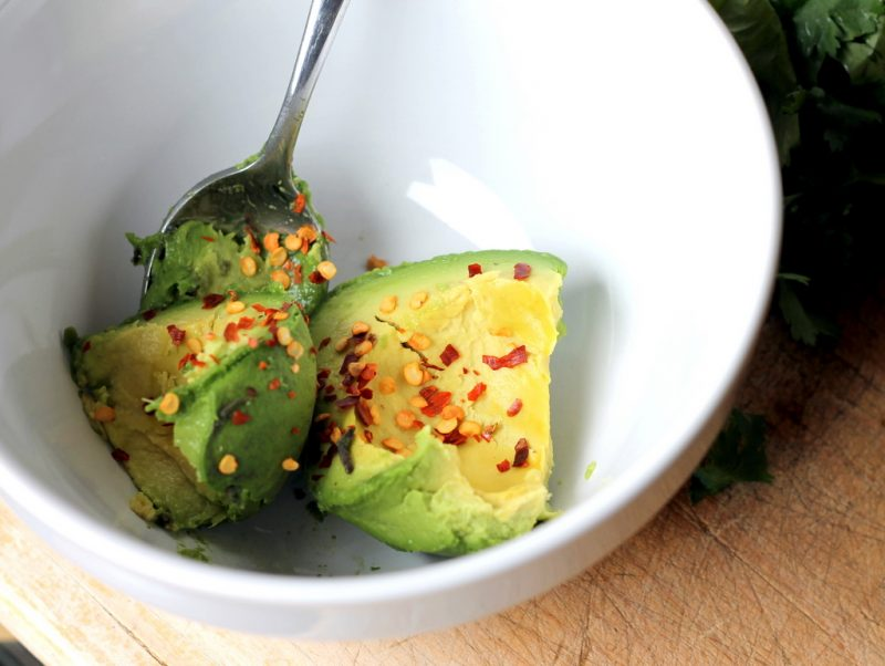 avocado with red pepper flakes in bowl