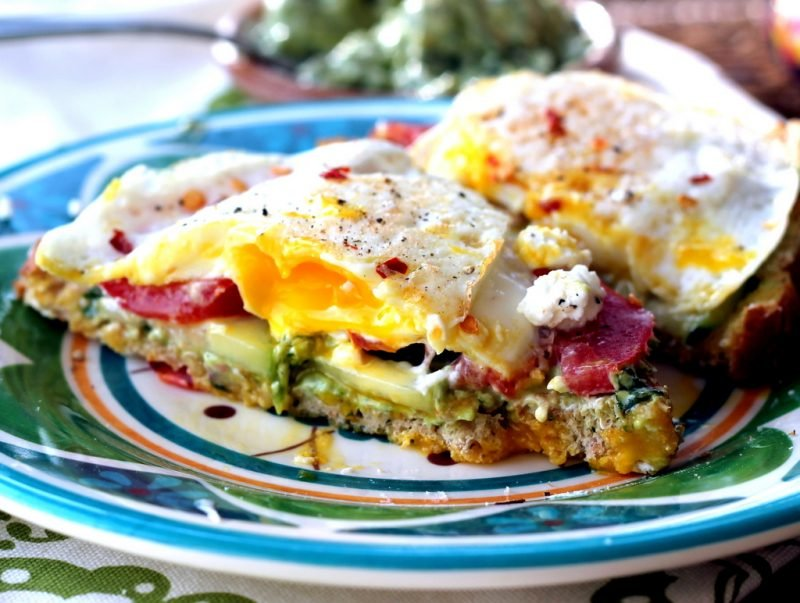 egg sandwich with avocado and bacon