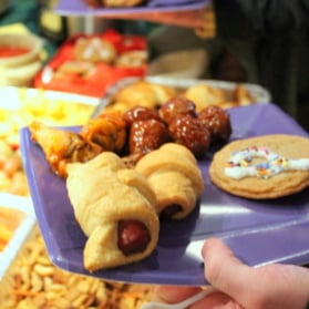 holding plate with party snack foods