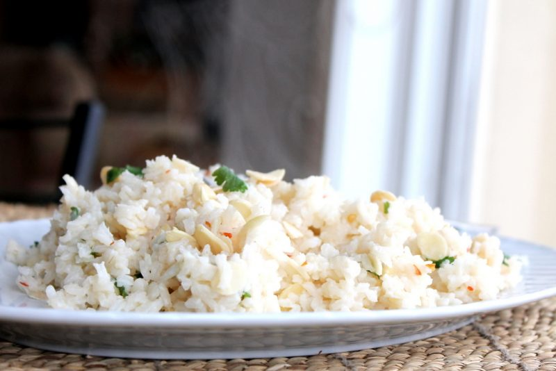 plate of rice with almonds and cilantro