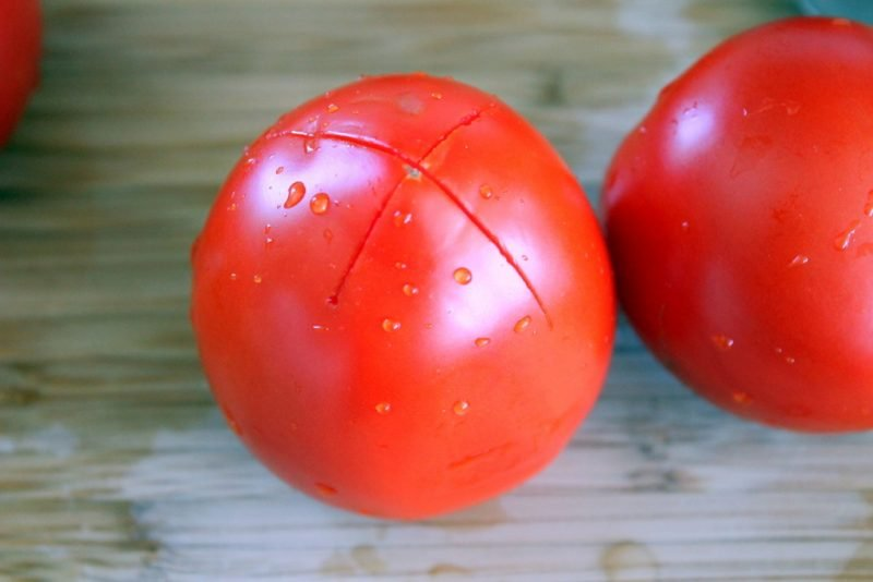 tomato on cutting board