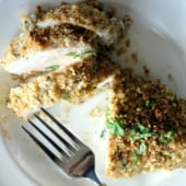 crusted chicken breast cut on plate