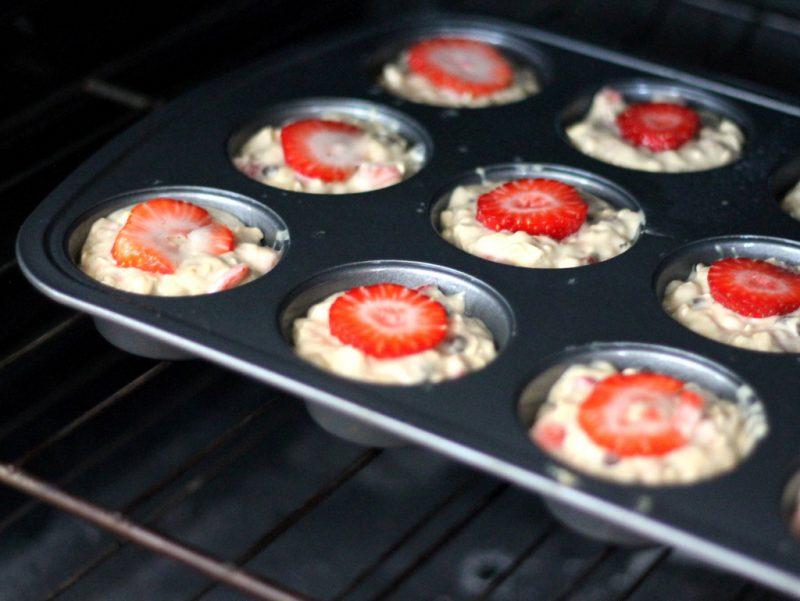 strawberry banana muffins baking in oven