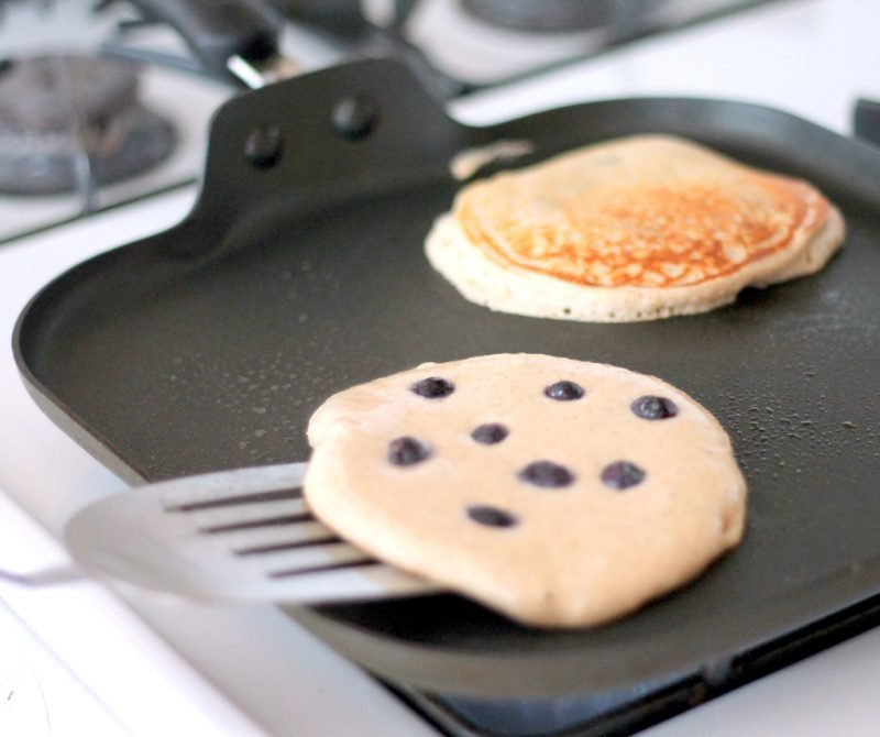 flipping cottage cheese pancakes on griddle