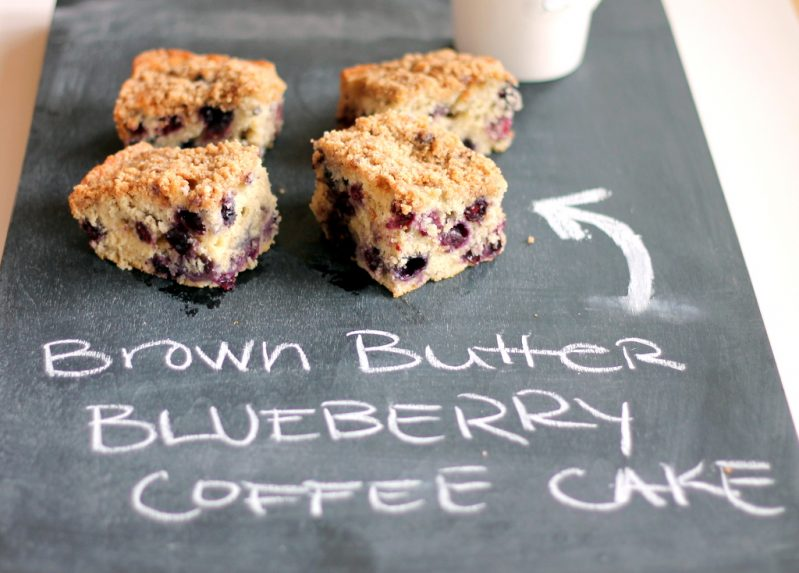 pieces of blueberry coffee cake on slate serving board with chalk writing