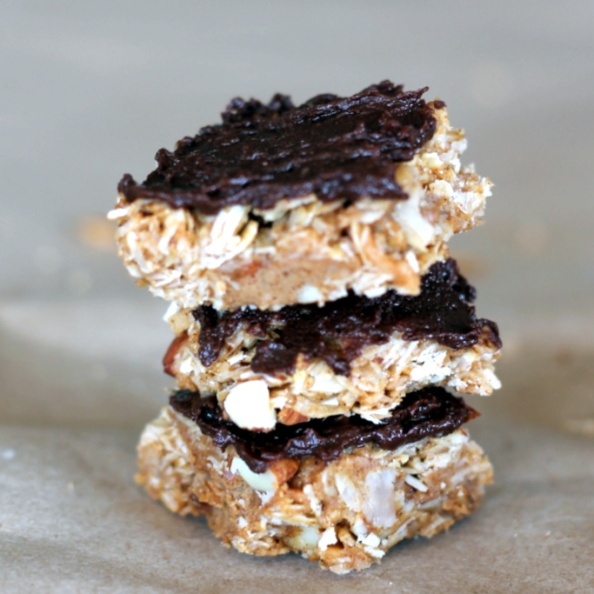 stack of homemade coconut almond granola bars with dark chocolate