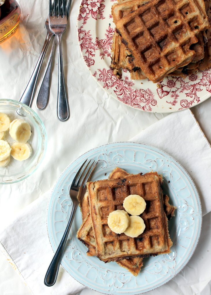 waffles on plates with banana slices on top
