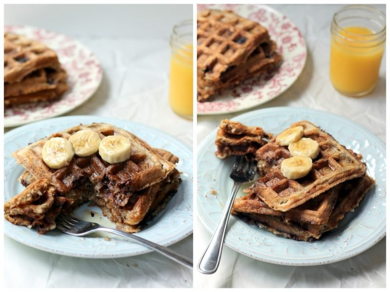 stack of waffles on plate with banana slices and orange juice