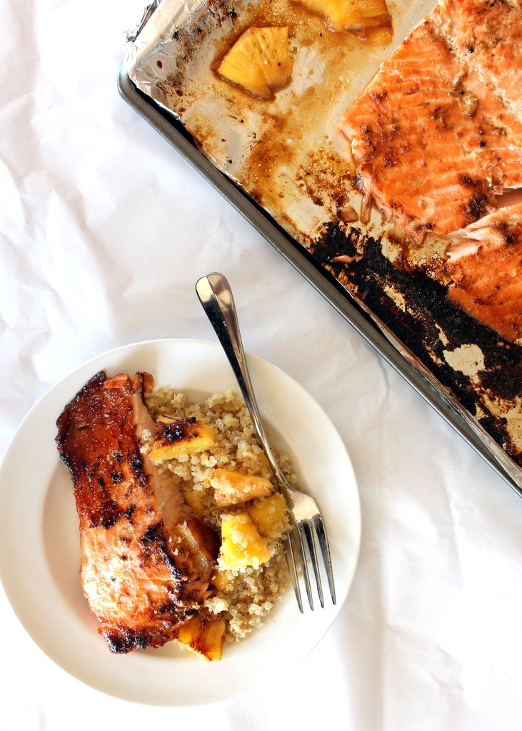 salmon with quinoa and pineapple on plate