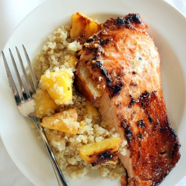 : salmon with quinoa and pineapple on plate