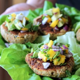 chickpea lentil burger with mango and avocado on plate with lettuce