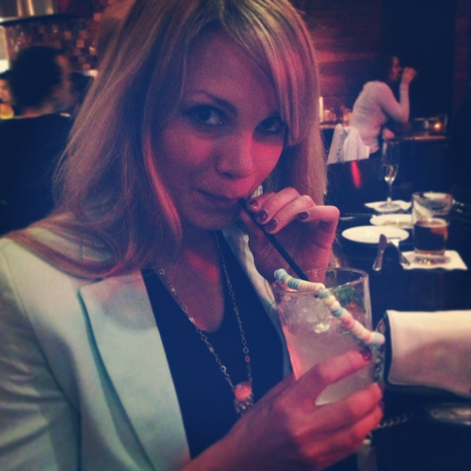 monique sipping a drink