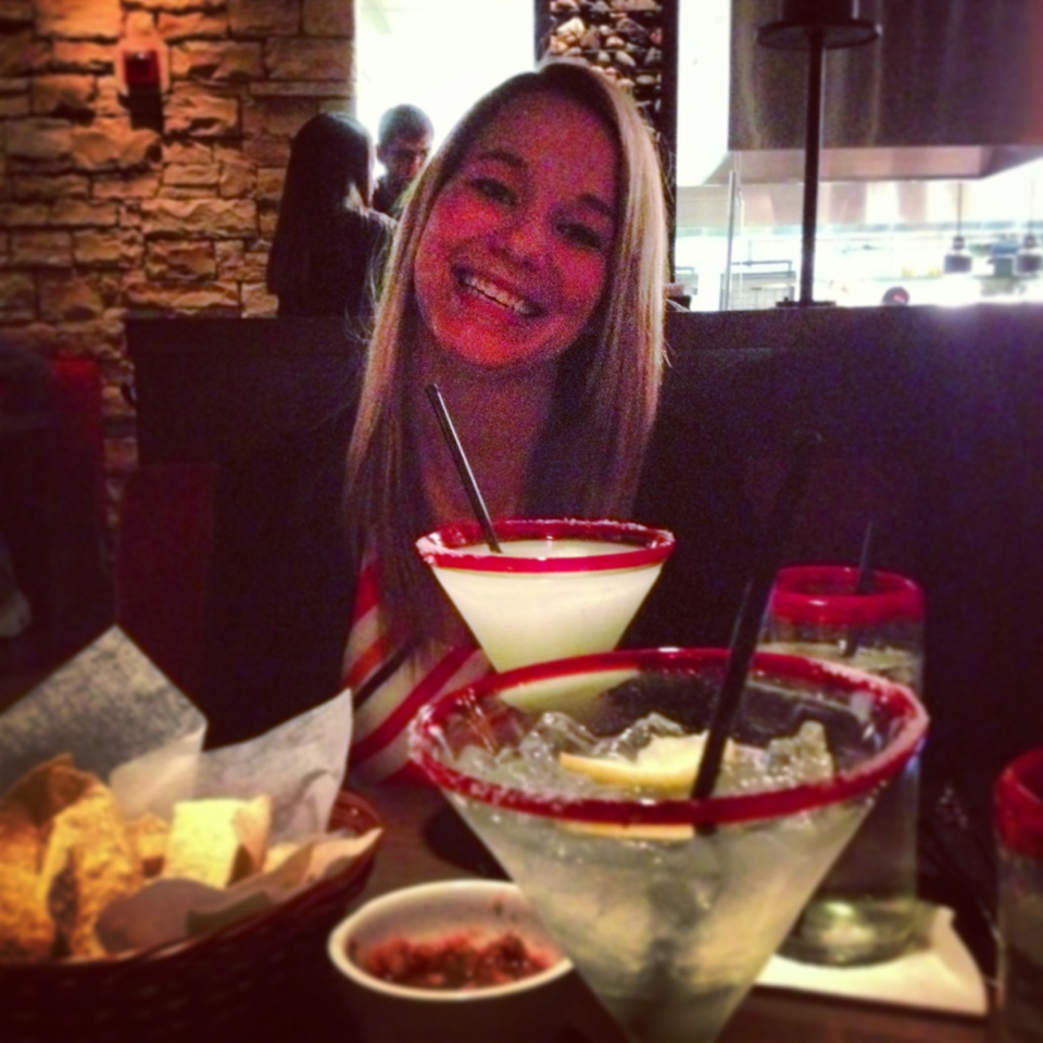 blonde woman at a table with margaritas
