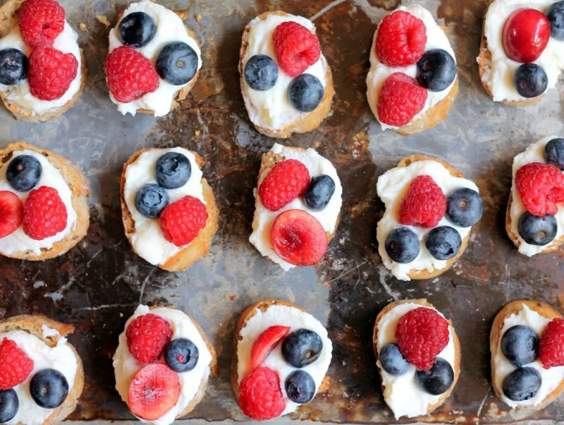 crostini with ricotta and berries on pan