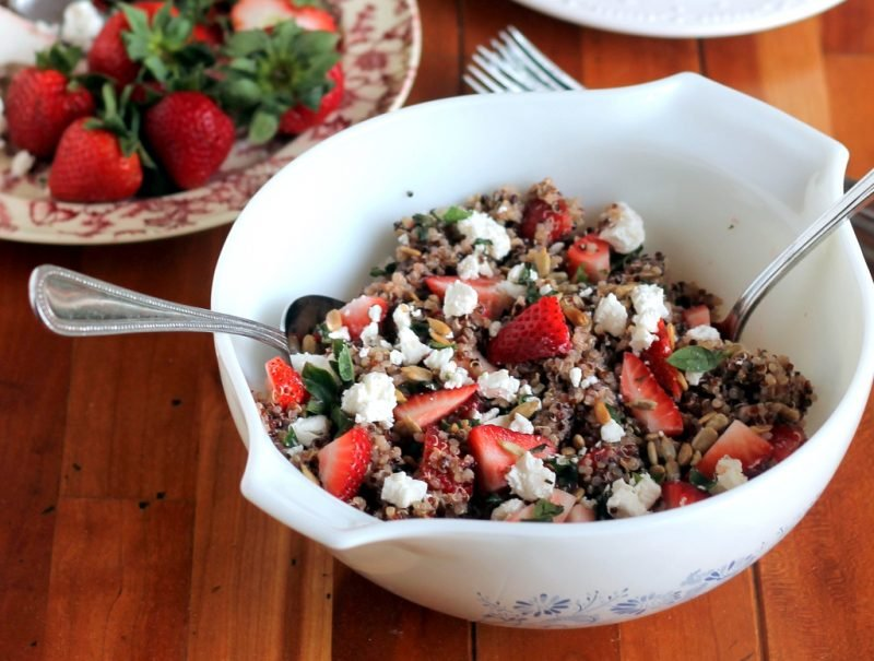 strawberry basil quinoa salad in bowl in table