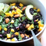 black rice salad in bowl with mango and avocado