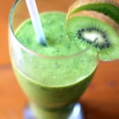 healthy green smoothie in glass with kiwi fruit