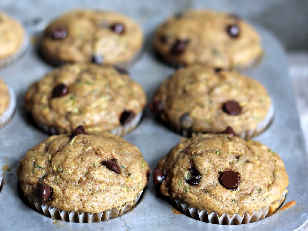 zucchini banana chocolate chip muffins in a muffin tin