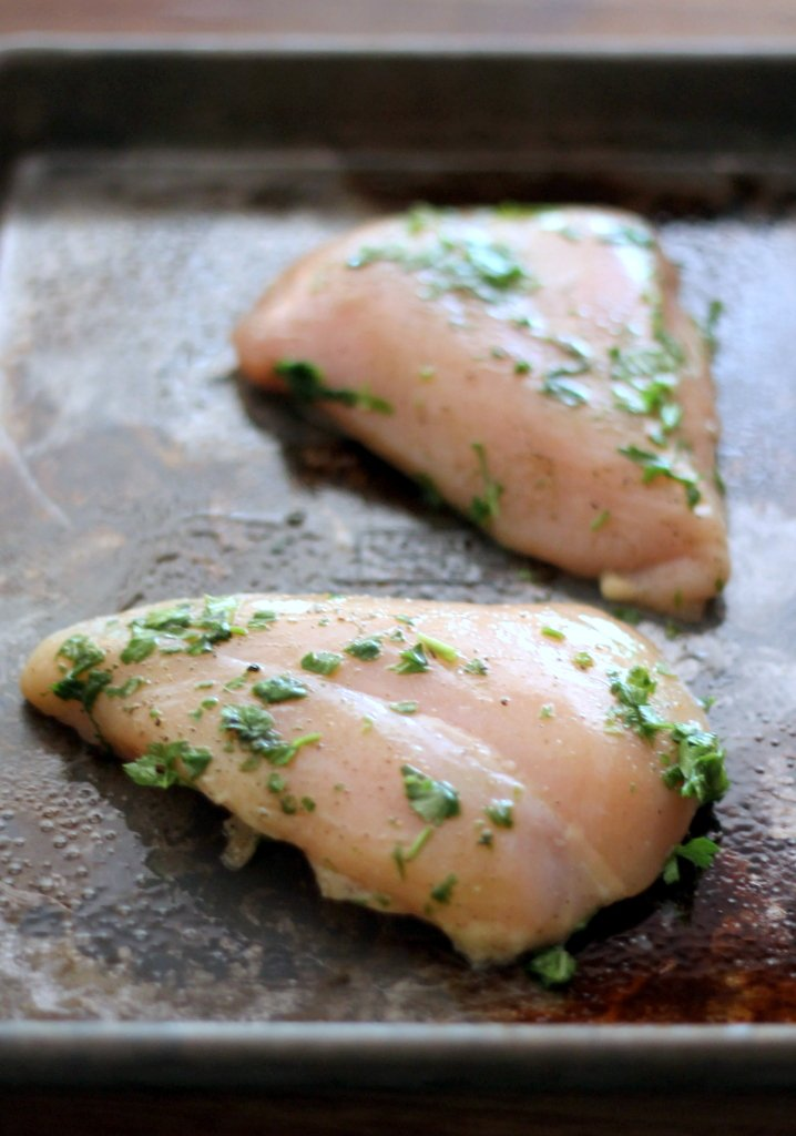 The chicken is massaged with a bit of olive oil, garlic, fresh basil ...