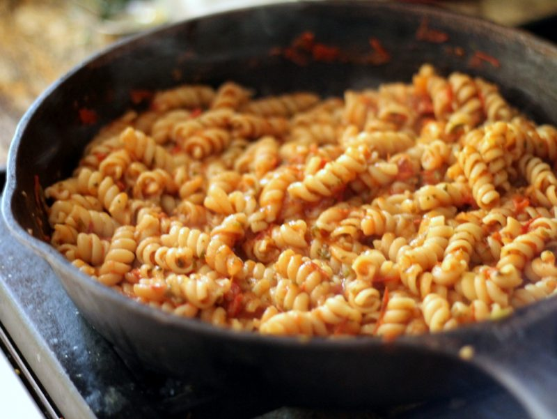 pasta with tomato sauce in skillet