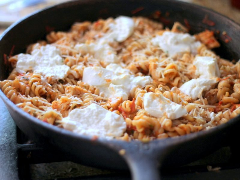 pasta with tomato sauce and cheese in skillet
