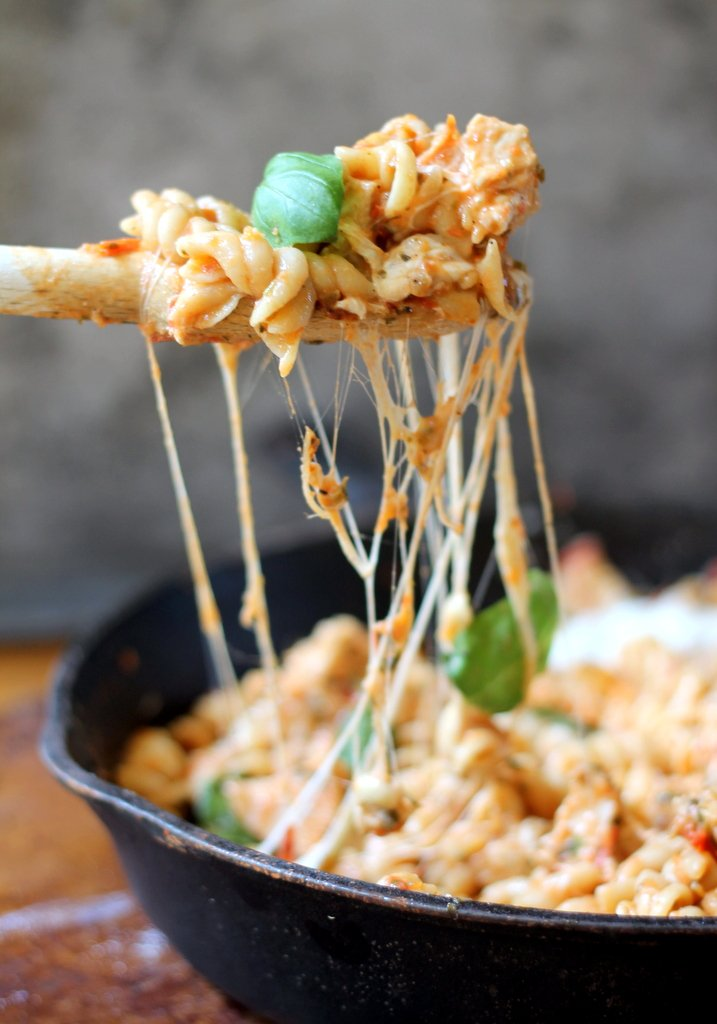 : pasta with chicken and cheese in skillet