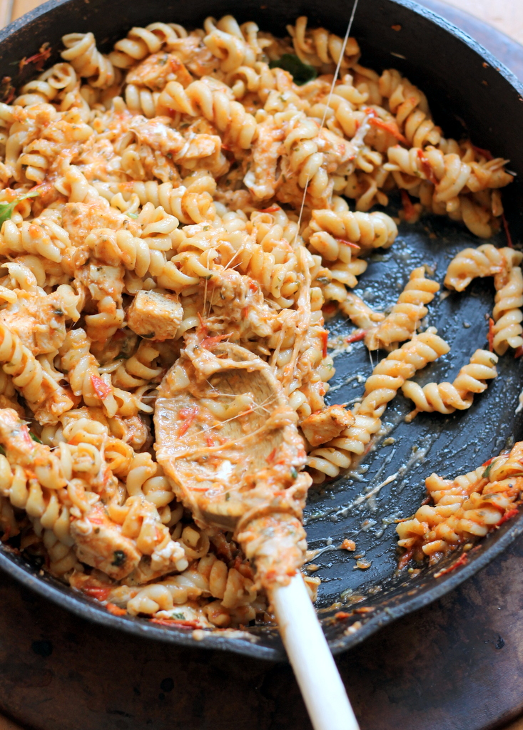 pasta with chicken and cheese in skillet