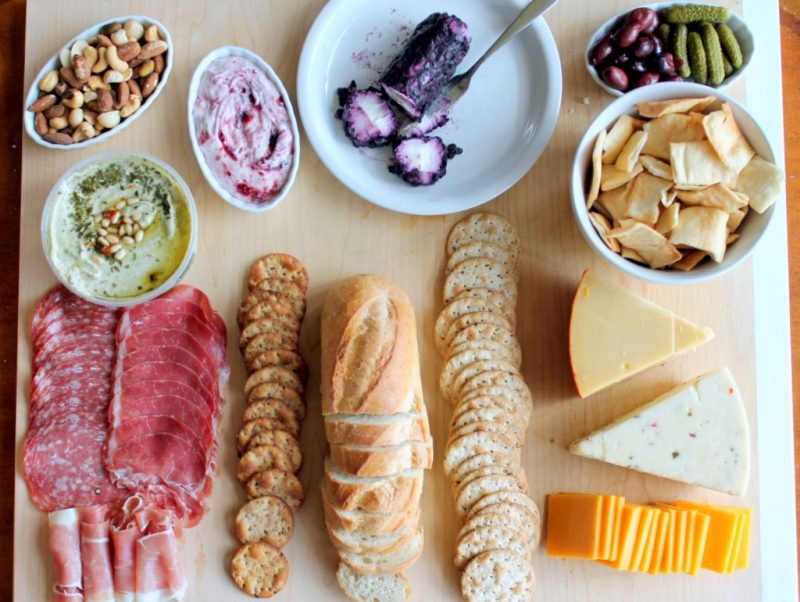 meats, cheese, and crackers on serving board